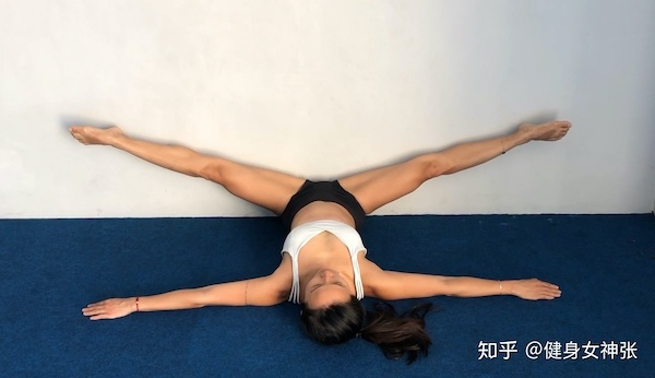 Woman doing middle split exercise warmup